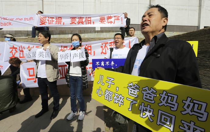 Family member of a passenger onboard the Malaysia Airlines Flight MH370 shouts slogans during a protest in Beijing