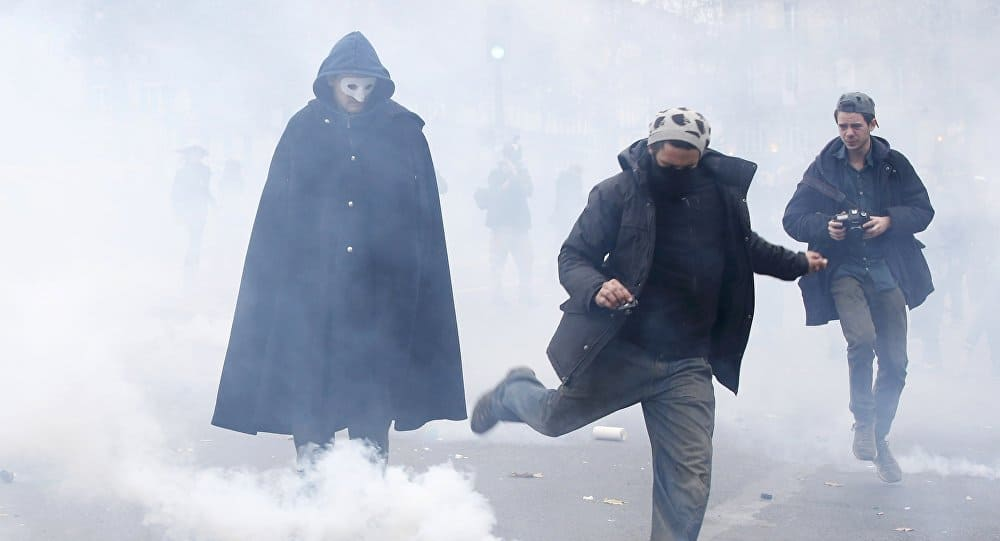 French Police Use Tear Gas at Banned Climate Change Rally in Paris 100 Arrested